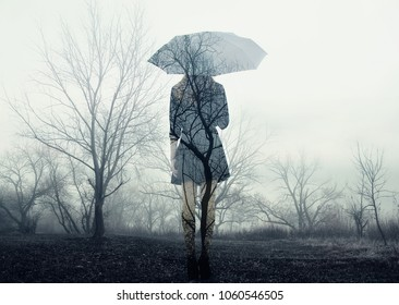 Girl with umbrella standing on the field with trees. Rain. Loneliness. The image with the effect of double exposure