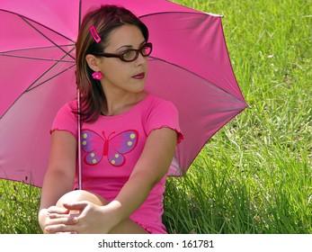 girl with umbrella and sunglasses