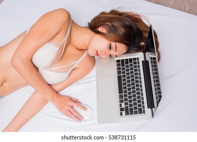 girl in underwear on bed with laptop, girl in underwear on bed with notebook, woman and computer