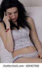 Girl in underwear talking on mobile phone
