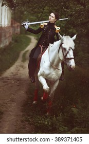 Girl in uniform with sword on her shoulder riding white horse.