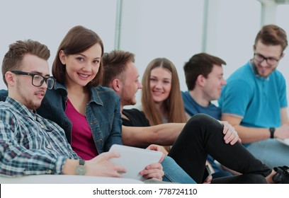 girl University student with friends sitting in the lobby and ta