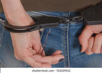 girl unlocking handcuffs on white background