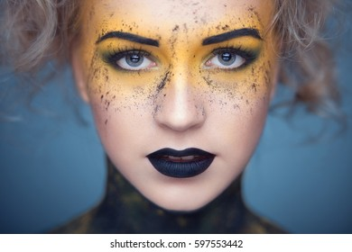 Girl with unusual make-up. Art make-up.