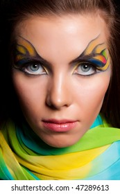 Girl and unusual make-up. Close up.