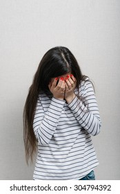 Girl upset and covers her face with her hands
