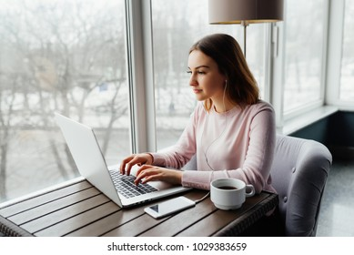 Girl use Laptop huge Loft Studio.Student Researching Process Work.Young Business Woman Working Creative Startup modern Office.Analyze market stock,new strategy. Horizontal