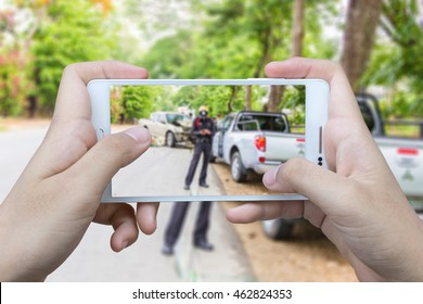 Girl use mobile phone , blur image of accident on the road as background.