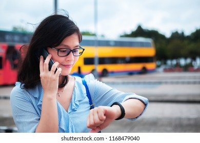 Girl use smartphone on bus station