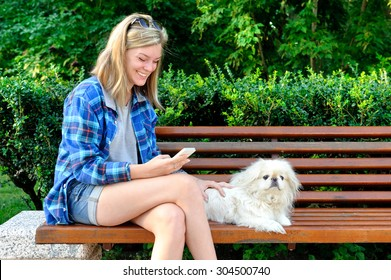 Girl using a cell phone outdoors.