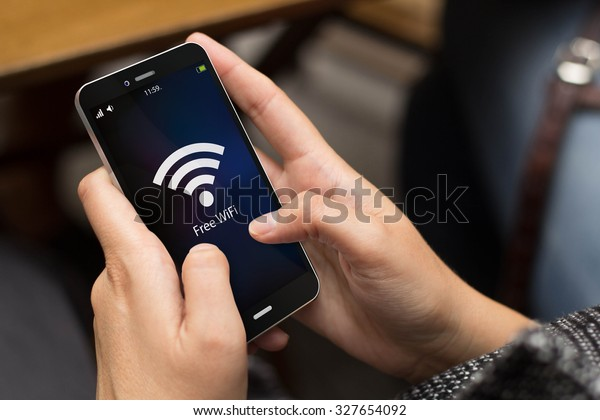 girl using a digital generated phone with free wifi on the screen. All screen graphics are made up.