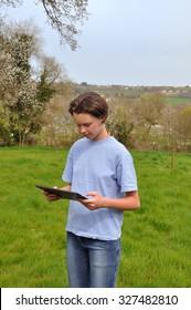 Girl using digital tablet