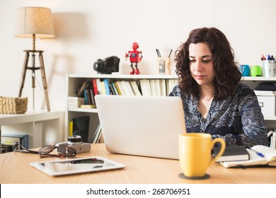 Girl using her laptop at home.