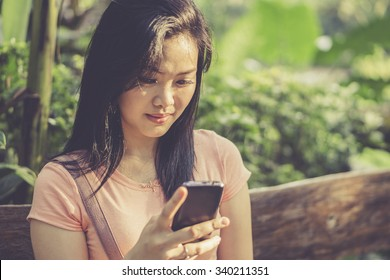 Girl using and holding a smart phone