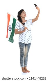 Girl using mobile with Indian flag or tricolour on white background, Indian Independence day, Indian Republic day