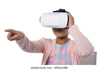 Girl using virtual reality headset against white background