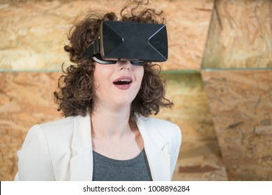Girl using VR glasses having fun, concept