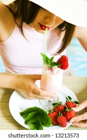 Girl at vacation with cold strawberry cocktail