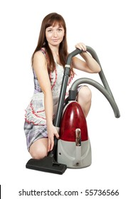 Girl in with vacuum cleaner. Isolated over white background