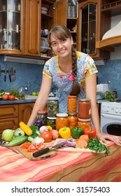 Girl with vegetables  in the kitchen
