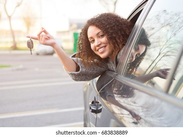 Girl very happy after purchasing a new car