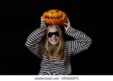 girl in vest and mask in Halloween
