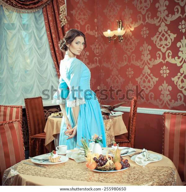 Girl in vintage dress in cafe. elegant pretty woman in vintage evening dress. Retro Woman Portrait. Romantic Beauty.Vintage Styled