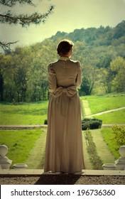Girl in vintage dress walking in the park