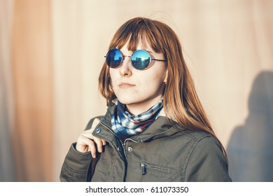 Girl in vintage round mirror glasses outdoors