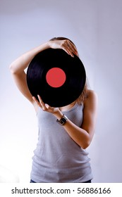 girl with vinyl disc closeup