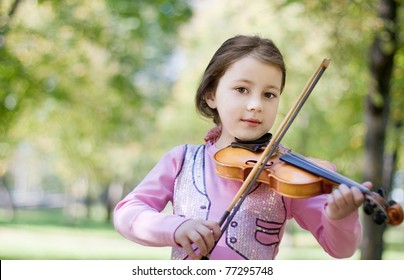 girl with violin outdoor