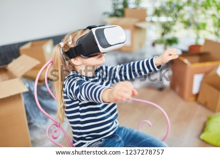 4b831128f2 Girl with virtual reality glasses goes through a virtual house as a  simulation