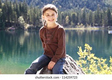 Girl visiting the Hintersee, Berchtesgadener Land, Bavaria, Germany