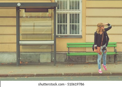Girl waiting for a bus.