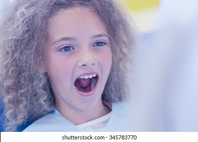 Girl waiting for a dental exam at the dental office