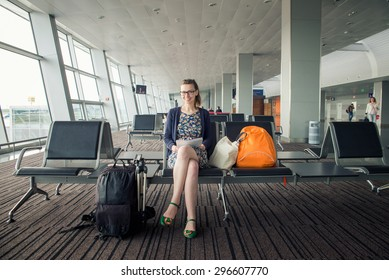 Girl waiting for the plane at the airport