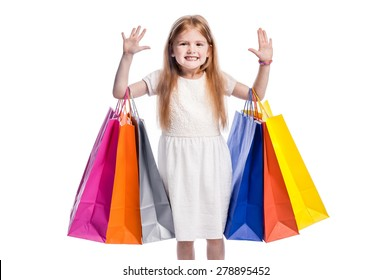 Girl waiving to camera with lots of shopping. Isolated in studio on white background.