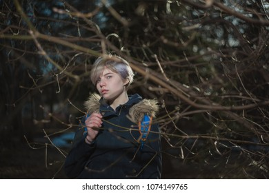Girl walk among the tree branches in the Park