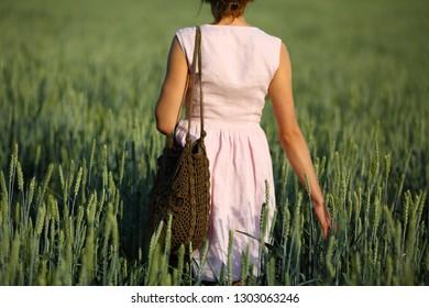 Girl walk in rustick field countryside on green background