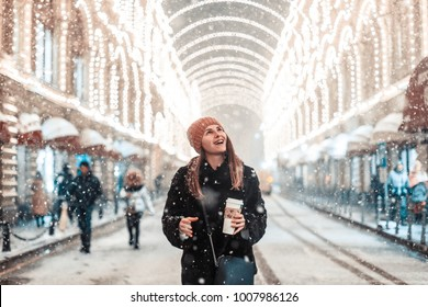 Girl is walking along the red square in Moscow in the new year