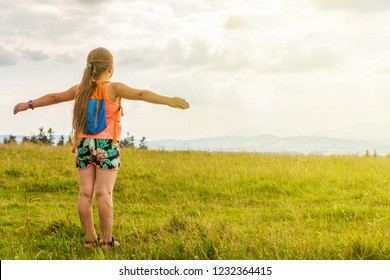 Girl walking around the park and meadow