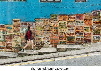 Girl walking in the colorful street in Hong Kong city