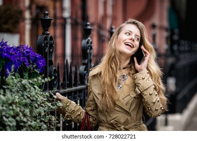 Girl walking down the street with her phone