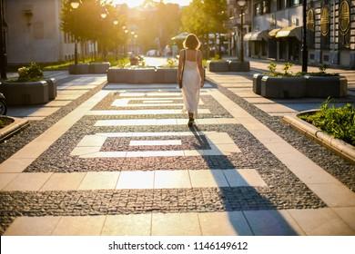 Girl walking on center Millennium on Obilic's in Belgrade, Serbia