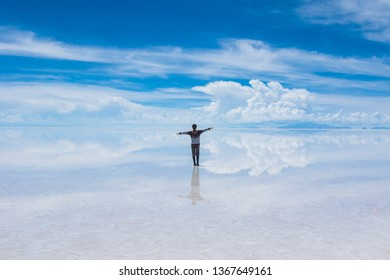 Girl walking on the clouds in salt flats