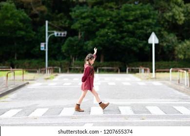 Girl walking on a crosswalk