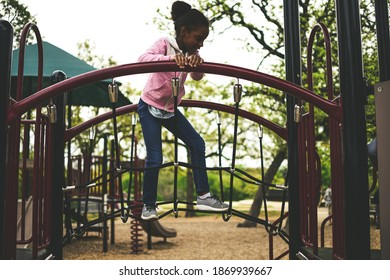 Girl Walking on the Jungle Gym