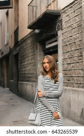 Girl walking on the old streets of Barcelona