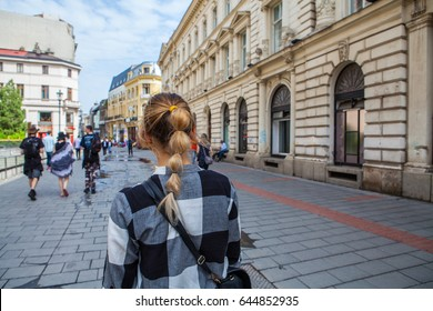 Girl walking on old streets of Bucharest. Romania. Europe. Traveler. City Brake
