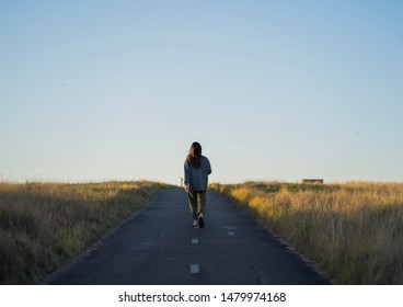 Girl walking on path in nature